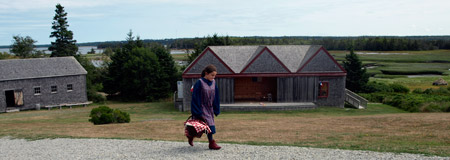 Young Girl walking through the Historic Acadian Village in Pubnico
