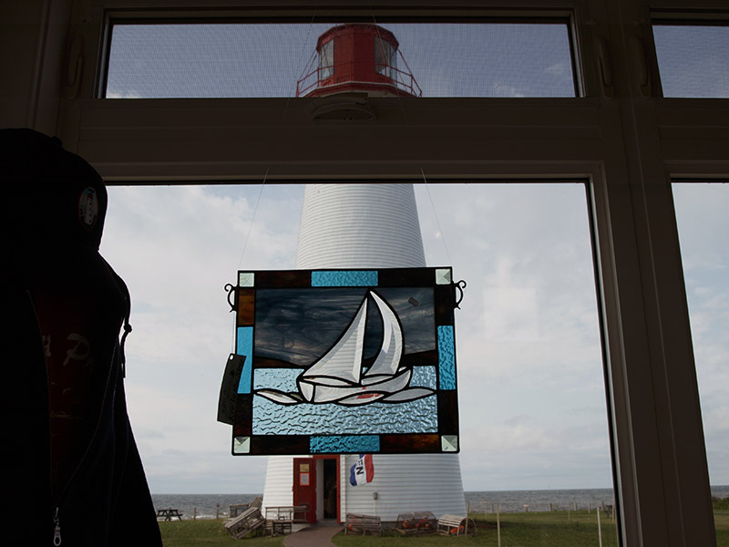 art-peice-with-lighthouse-backdrop